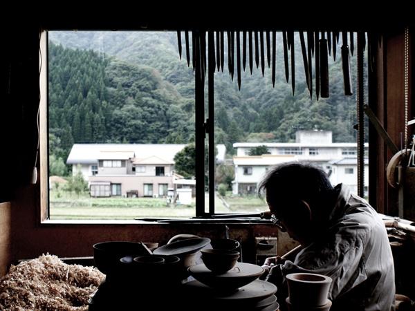 Woodturner in Yamanaka.